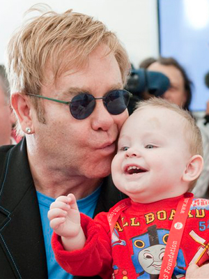 Elton John with his surrogate baby